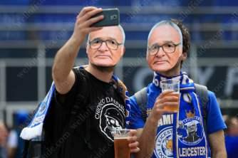 Leicester fans wearing Claudio Ranieri masks