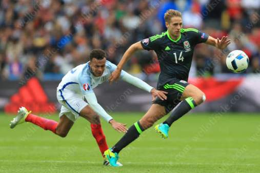 Dave Edwards of Wales gets away from Dele Alli of England