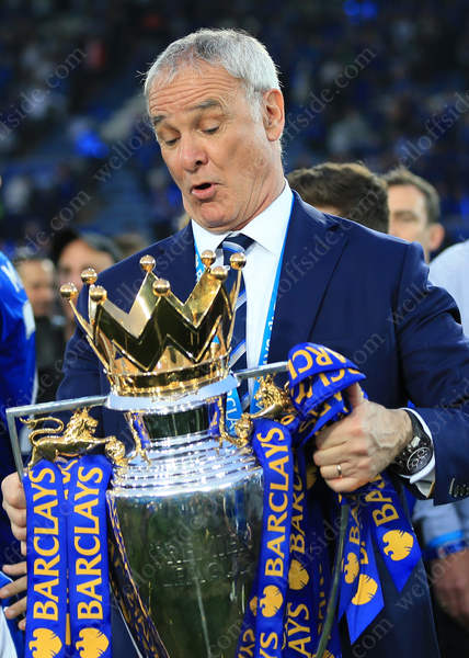 Leicester manager Claudio Ranieri gets to grips with the trophy