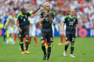 Aaron Ramsey of Wales looks dejected following his side's defeat