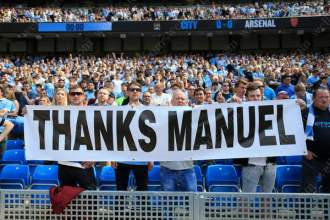 Man City fans display a banner thanking outgoing Man City manager Manuel Pellegrini