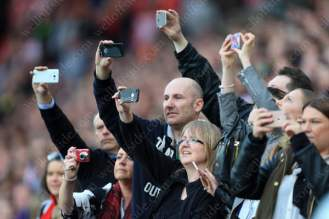 Fans record the action on their mobile phones