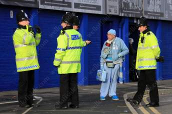 A Man City fan chats to police