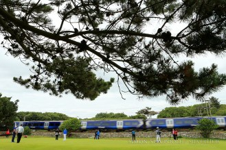 TROON, SCOTLAND - JULY 12: A train passes by the 11th green during the penultimate practice round prior to the 145th Open Championship at Royal Troon Golf Club on 12th July 2016 in Troon, Scotland. Photo by Simon Stacpoole/SilverHub 0203 174 1069 / 07711 972644
