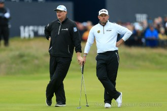 TROON, SCOTLAND - JULY 14: Ernie Els (RSA) (L) and Lee Westwood (ENG) stand alongside each other during the 145th Open Championship at Royal Troon Golf Club on 14th July 2016 in Troon, Scotland. Photo by Simon Stacpoole/SilverHub 0203 174 1069 / 07711 972644