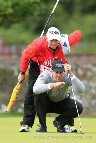TROON, SCOTLAND - JULY 16: Henrik Stensen (SWE) lines up a putt with his caddie during the 145th Open Championship at Royal Troon Golf Club on 16th July 2016 in Troon, Scotland. Photo by Simon Stacpoole/SilverHub 0203 174 1069 / 07711 972644
