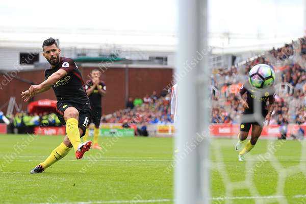 Sergio Aguero scores a penalty for Man City during their victory away to Stoke City