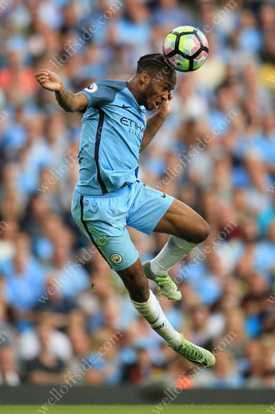 Raheem Sterling of Man City heads the ball back into play