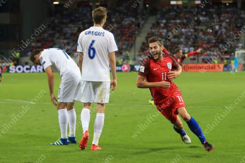 Adam Lallana celebrates after scoring a late winner against Slovakia