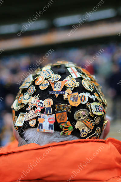 A Hull fan with a cap adorned with pins and badges