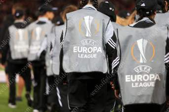 Mascots wear branded UEFA Europa League bibs as they walk out onto the pitch at Old Trafford