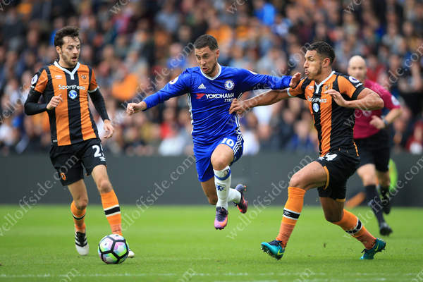 Eden Hazard of Chelsea skips between Ryan Mason of Hull (L) and Jake Livermore of Hull