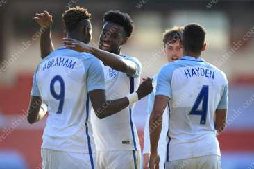 Tammy Abraham of England (L) celebrates with teammate Joshua Onomah of England after scoring their 5th goal