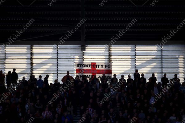 Sun shines through the back of the stand onto a banner during Stoke City's Premier League match at home to Sunderland