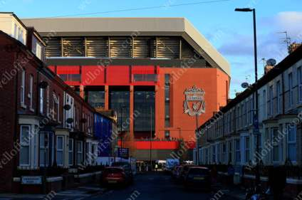 Liverpool's Anfield Stadium glows red as it towers over the nearby terraced houses ahead of the match between Liverpool and Manchester United