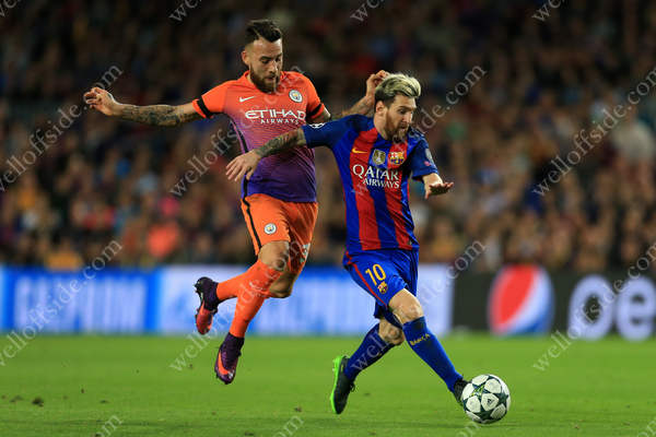 Lionel Messi of Barcelona gets away from Nicolas Otamendi of Man City
