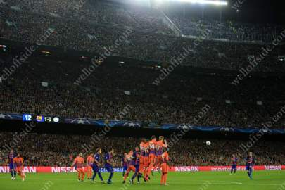 Lionel Messi of Barcelona takes a free-kick inside the Nou Camp
