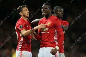 Paul Pogba of Man Utd (C) celebrates with teammates Matteo Darmian (L) and Eric Bailly after scoring their 3rd goal