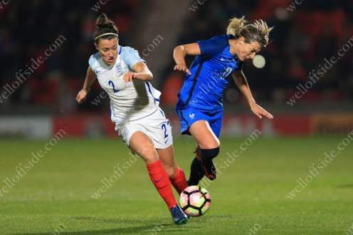 Lucy Bronze of England battles with Claire Lavogez of France