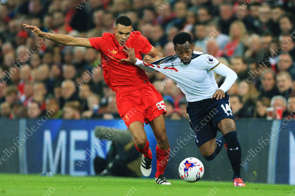 Trent Alexander-Arnold of Liverpool battles with Georges-Kevin Nkoudou of Spurs as the two side's clash in the EFL Cup 4th Round at Anfield