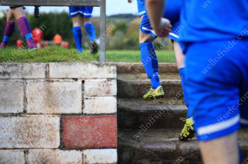 Brixham's players make their way up the steps onto the pitch for the 2nd half
