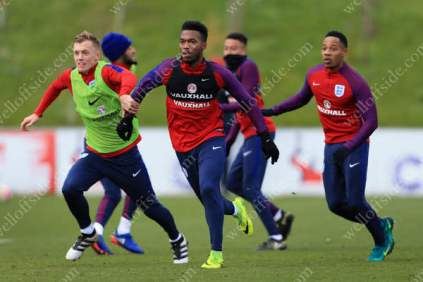 Daniel Sturridge (C) and James Ward-Prowse vie for space during an England training session