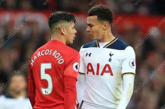 Dele Alli of Spurs squares up head-to-head to Marcos Rojo of Man Utd
