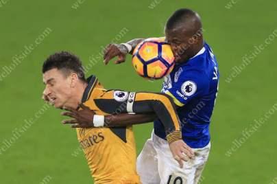 Laurent Koscielny of Arsenal battles with Enner Valencia of Everton