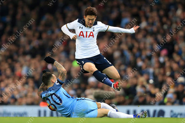 Son Heung-Min of Spurs skips over a challenge from Nicolas Otamendi of Man City