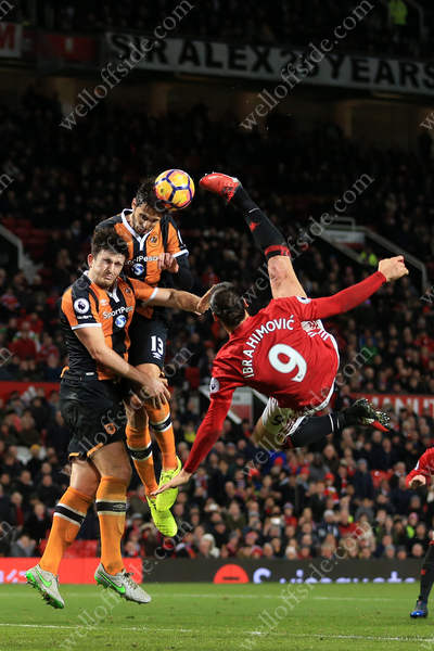 Zlatan Ibrahimovic of Man Utd tries a spectacular overhead kick as Harry Maguire of Hull (L) and Andrea Ranocchia of Hull (C) challenge