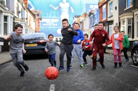 Children play football in the streets around Goodison Park before the match between Everton and Bournemouth
