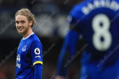 Tom Davies of Everton gives a cheeky look towards teammate Ross Barkley