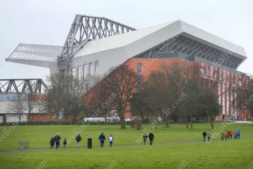 Liverpool fans walk across Stanley Park towards Anfield
