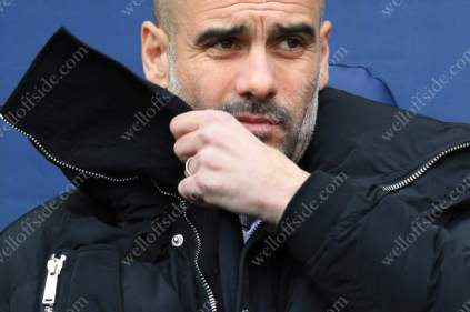 Man City manager Pep Guardiola looks dejected