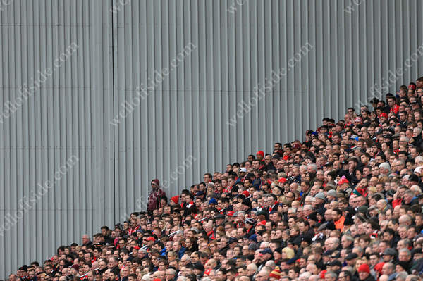 A single Liverpool fan finds the need to stand