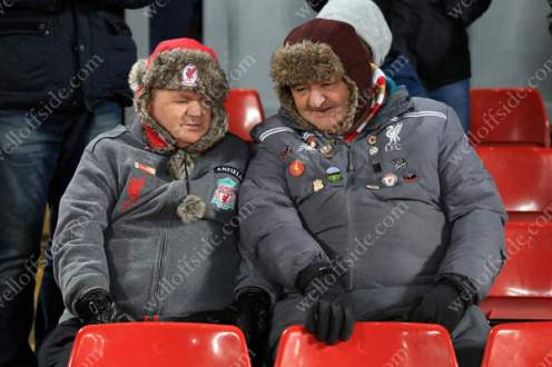 A pair of Liverpool fans keep themselves warm with matching hats