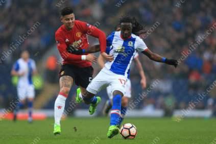 Marcos Rojo of Man Utd battles with Marvin Emnes of Blackburn