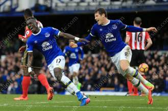 Idrissa Gueye of Everton (L) celebrates with teammate Ross Barkley after scoring their 1st goal