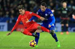 Christian Fuchs of Leicester battles with Roberto Firmino of Liverpool