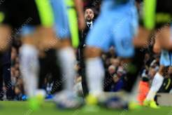 Man City manager Pep Guardiola watches his side take on Huddersfield Town in an FA Cup 5th Round replay