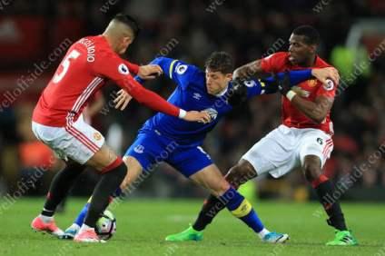 Ross Barkley of Everton battles with Marcos Rojo of Man Utd (L) and Paul Pogba of Man Utd (R)