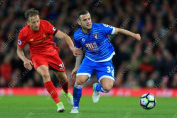 Jack Wilshere of Bournemouth battles with Lucas Leiva of Liverpool
