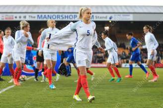Steph Houghton of England removes her training jacket ahead of kick-off in their international friendly against Italy