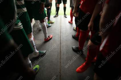 Players wait in the tunnel