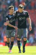 Cedric Soares of Southampton (L) and teammate James Ward-Prowse congratulate each other after the match