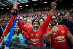 Man Utd fans cheer on their team