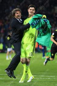 Chelsea manager Antonio Conte embraces Chelsea goalkeeper Thibaut Courtois as they celebrate winning the title
