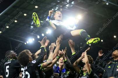 Chelsea players throw their captain John Terry in the air as they celebrate winning the title