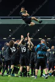 Chelsea players throw Pedro in the air as they celebrate winning the title