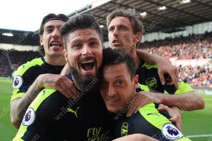 Mesut Ozil of Arsenal (R) celebrates with teammates Olivier Giroudl (2L), Hector Bellerin (L) and Nacho Monreal (2R) after scoring their 2nd goal